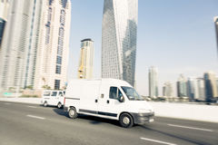 Van Going Fast. Dubai skyscrapers in the background. panning shot with motion blur Royalty Free Stock Photography