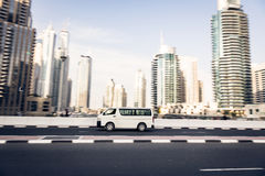Van Going Fast. Dubai skyscrapers in the background. panning shot with motion blur Stock Photography