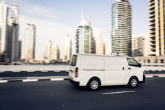 Van Going Fast. Dubai skyscrapers in the background. panning shot with motion blur Royalty Free Stock Photo