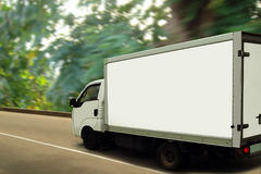 Van, green forest. Ecological transport concept. The fast delivering van is moving on highway with the blurred green forest on background concept green Royalty Free Stock Images