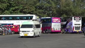 Van of Greenbus company. CHIANGMAI, THAILAND - JANUARY 2 2015:   Van of Greenbus company, Route Lampang and Chiangmai. Footage at Chiangmai bus station, thailand stock video footage