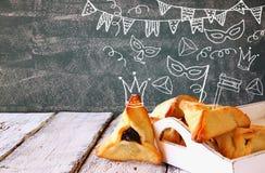 Van Hamantaschenkoekjes of hamans oren de viering van Purim Stock Fotografie