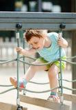 3 van het babyjaar meisje bij speelplaats Stock Fotografie