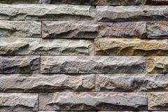 Van het baksteenpatroon ruwe oppervlakte als achtergrond Stock Afbeeldingen