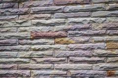 Van het baksteenpatroon ruwe oppervlaktemuur als achtergrond Royalty-vrije Stock Foto's