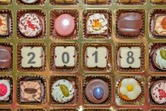 Van het chocoladesnoepjes en suikergoed nieuw jaar 2018 Stock Afbeelding