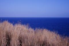 van het de aardclose-up van de zonsondergangzomer het mooie blauwe overzees Stock Foto