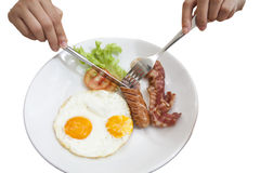 Van het de holdingstafelzilver van de ontbijthand de nadrukworst Royalty-vrije Stock Fotografie
