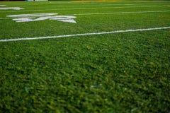 Van het de hoogtegras van het voetbalhof de close-up van de poollijnen royalty-vrije stock afbeelding