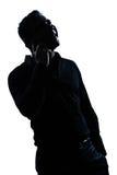 Van het de mensenportret van het silhouet de gelukkige telefoon Royalty-vrije Stock Foto's