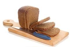 Van het de roggebrood van plakken het messenraad Royalty-vrije Stock Foto