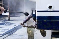 Van het de schil schoonmakende water van de boot de drukwasmachine Stock Foto's