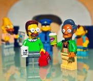 Van het de stadsblok van Legomensen het licht van de de studiokwaliteit stock afbeelding