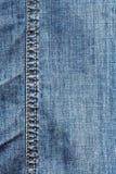 Van het de textuur blauwe denim van de foto de jeansbroeken Stock Foto