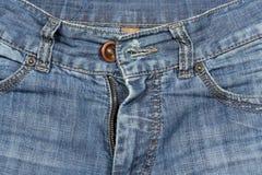 Van het de textuur blauwe denim van de foto de jeansbroeken Stock Afbeelding