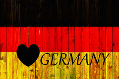 Van het de vlagsymbool van Duitsland van het achtergrond land de nationale Duitse Houten omheining Heart patriottische textiel va Royalty-vrije Stock Foto