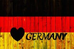 Van het de vlagsymbool van Duitsland van het achtergrond land de nationale Duitse Houten omheining Heart patriottische textiel va Royalty-vrije Stock Fotografie