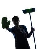 Van het het meisjehuishoudelijk werk van de vrouw silhouet van het het eindegebaar het brooming Royalty-vrije Stock Foto's