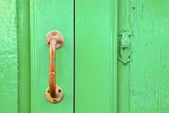 Van het messingskloppers van Spanje abstract de deurhout in Stock Afbeelding