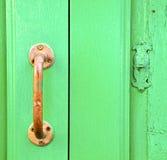 Van het messingskloppers van Spanje abstract de deurhout in Royalty-vrije Stock Foto