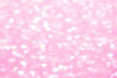 Van het onduidelijk beeldhart roze mooie schittert romantisch als achtergrond, bokeh zacht de pastelkleurroze van het lichtenhart stock foto