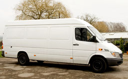 Van with indicators. White Van with Indicators flashing parked by greenhouse Royalty Free Stock Photography