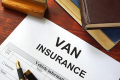 VAN insurance form. On a table with a book Stock Photos