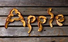 Van letters voorziend Apple van droge stukken Stock Foto