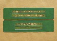 Van letters voorziend gidsmalplaatje Stock Afbeeldingen