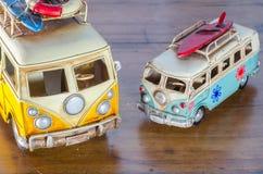 Van. Miniature van laying on a wooden table Stock Photo