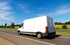 Van on the Move. Clean White Van on a freeway or motorway Royalty Free Stock Image