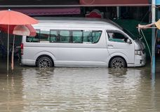 Van are moving in a flooded street. Floods in the market in Samut Prakan, Thailand royalty free stock photo