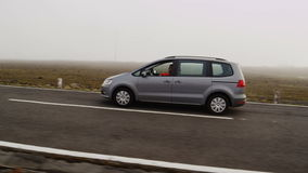 Van Moving on a Road. Aerial Shot from Madeira. Travelling by car visible from the drone. Long shot stock footage