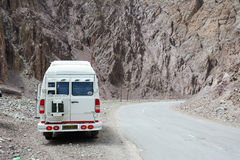 A van parking on mountain road in Ladakh, India Royalty Free Stock Images