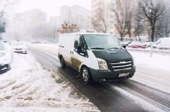 Van que conduce en invierno Fotografía de archivo libre de regalías