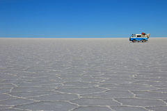 Van on Salar de Uyuni, salt lake, Bolivia royalty free stock images