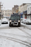 Van struggles to navigate Bristol streets in the snow Stock Photography