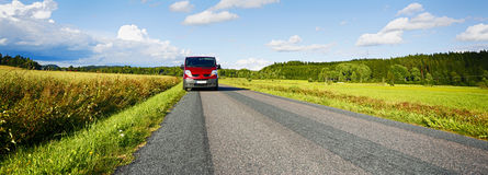 Van, suv, driving a long country road Stock Images