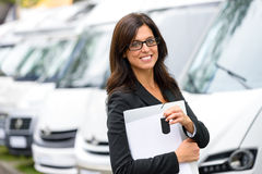 Van transport rental. Successful sales business woman in van transport trade fair. Commercial exhibition and rental vehicle concept. Beautiful female seller or stock image