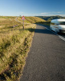 Van on countryside road. Van traveling on winding countryside road Stock Images