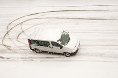 Van turning on winter street Royalty Free Stock Images