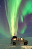 Van under the Aurora Borealis. Northern Lights stock photo
