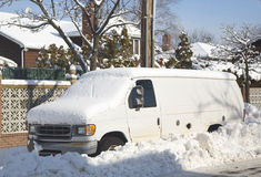 Van under snow in Brooklyn after massive winter storms strikes Northeast Stock Photos