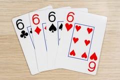 4 van vriendelijke sixes 6 - casino het spelen pookkaarten stock afbeeldingen