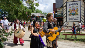Vana Mazi. Three musicians from the band Vana Mazi make their way to the stage, playing for the audience during the Bristol Renaissance Faire Royalty Free Stock Image