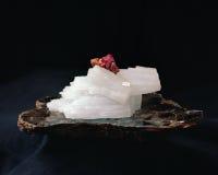Vanadinite. Red vanadinite crystal on white anhydrite on a slab of mica Stock Photo