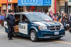 VANCÔVER, CANADÁ - 2 de fevereiro de 2014: Oficial do departamento da polícia de Vancôver na parada chinesa do ano novo Imagens de Stock