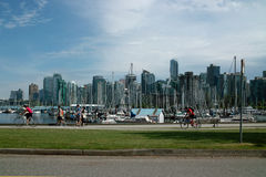 Vancouver B.C., Canada. Cyclists and pedestrians share the Stanley Park seawall, Vancouver B.C., Canada stock photography