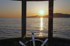 Vancouver Bay Sunset, steering wheel Royalty Free Stock Images