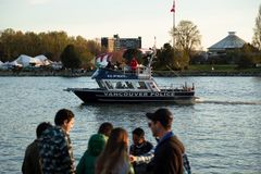 VANCOUVER, BC, CANADA - APR 20, 2019: A Vancouver Police boat patrolling the harbor at the 420 festival in Vancouver. royalty free stock photo